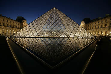 louve at night with pyramid, paris, france, water reflection