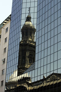 cthedran reflected in building in santaigo, chile
